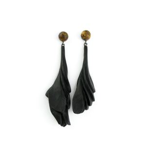 THE DIALOGUE BETWEEN PAST, PRESENT AND FUTURE  Contemporary asymmetric hand-carved amber + ebony earrings