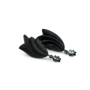 THE DIALOGUE BETWEEN PAST, PRESENT AND FUTURE  Contemporary asymmetric hand-carved ebony earrings with tiny topaz raindrops