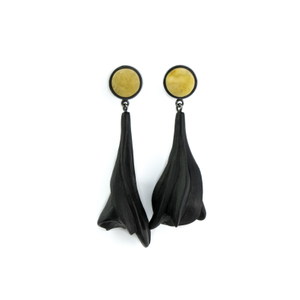 THE DIALOGUE BETWEEN PAST, PRESENT AND FUTURE  Contemporary asymmetric hand-carved amber earrings