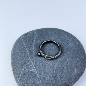 Minimal oxidized silver ring with a dark fresh-water pearl.