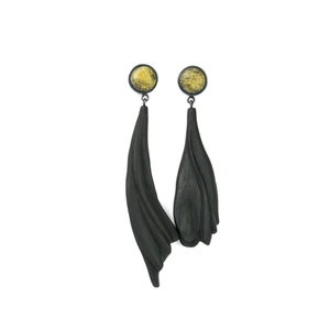 THE DIALOGUE BETWEEN PAST, PRESENT AND FUTURE Contemporary asymmetric handcarved amber earrings