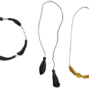 THE DIALOGUE BETWEEN PAST, PRESENT AND FUTURE 8 pieces of hand-carved and raw natural Baltic amber set into the oxidized silver piece comes along with with a long oxidized silver chain.