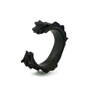 THE DIALOGUE BETWEEN PAST, PRESENT AND FUTURE Contemporary hand-carved ebony cuff